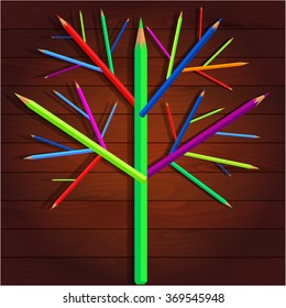 Tree of bright crayons on a wooden background
