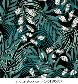 Trending abstract seamless pattern with colorful tropical leaves and plants on black background. Vector design. Jungle print. Flowers background. Printing and textiles. Exotic tropics. Fresh design.