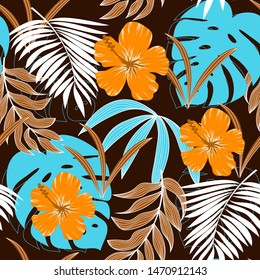 Trending abstract seamless pattern with tropical leaves and bright colors on blue background. Jungle seal. Vector design. The background floral. Textiles and printing. Exotic, tropical.