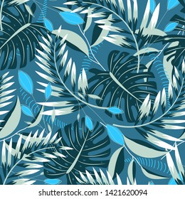 Trending tropical seamless pattern with bright leaves and plants on a dark background. Vector design. Jungle print. Floral background.