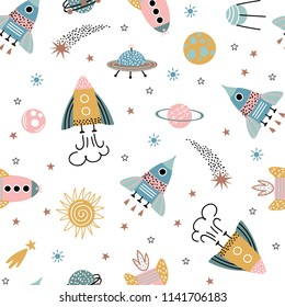 Trendy kids hand drawn a seamless pattern with planets and rockets. Baby vector background in a doodle style.