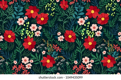 Trendy seamless floral pattern. Endless print made of  red flowers, leaves and berries. Summer and spring motifs. Modern floral texture. Dark blue background. Vector illustration.