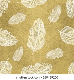 Trendy seamless pattern with feathers on gold background