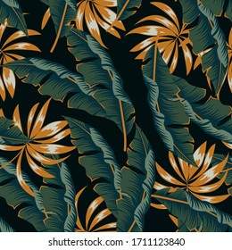 Trendy seamless tropical pattern with bright plants and leaves on a dark background. Trendy summer Hawaii print. Jungle leaf seamless vector floral pattern background.
