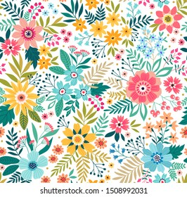 Trendy seamless vector floral pattern. Endless print made of small colorful flowers, leaves and berries. Summer and spring motifs. White. Vector illustration.