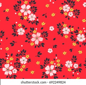 Trendy seamless vector floral pattern. Endless print made of small pink flowers, leaves and berries. Summer and spring motifs. Bright Red background.Vector illustration.