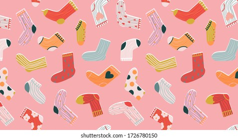 Trendy socks seamless pattern. Cozy hand-drawn cartoon style socks on a pastel pink background. Variety of funny socks. Modern vector design for stationery, textile and web use. Trendy apparel.