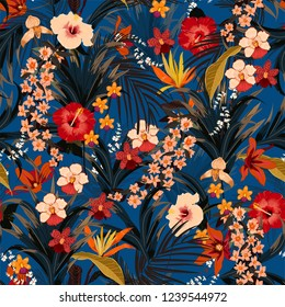 Trendy summer tropical background with deep jungle plants. Vector exotic pattern with palm leaves and flowers,orchid seamless vector design for fashion,fabric wallpaper and all prints on dark blue
