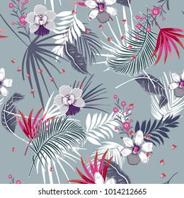 Trendy tropical seamless patternsummmer bright and colorful mix with forest flowers and exotic leaves on sky blue background.