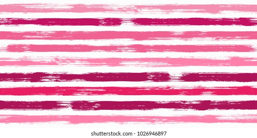 Trendy watercolor brush stripes seamless pattern. Pink, magenta, purple and red paintbrush lines horizontal seamless texture for backdrop. Hand drown paint strokes graphic artwork. For print.