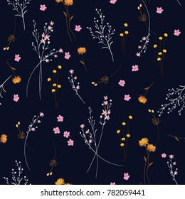 Trendy  wild blowing  Floral pattern in the many kind of flowers. Modern Wild botanical  Seamless vector texture. For fashion prints. Printing with in hand drawn style on navy blue  background.