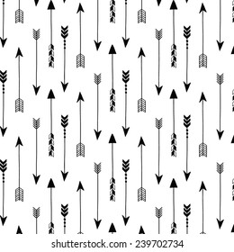 Tribal arrows on white background. Seamless vector pattern.