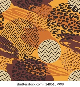 Tribal ethnic seamless pattern with animal print and brush strokes. Hand made effect. Vector background