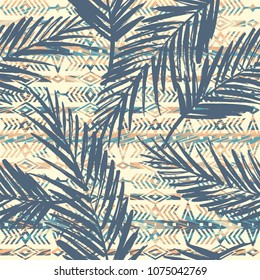 Tribal ethnic seamless pattern with palm leaves. Vector background