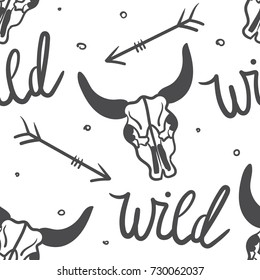 Tribal seamless pattern with skulls of animals, arrows, hand drawn background. Decorative ethnic ornament, wallpaper vector. Black and white backdrop, good for printing