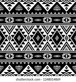 Tribal striped seamless pattern. Aztec geometric black-white background. Can be used in fabric design for making of clothes, accessories; decorative paper, wrapping, envelope; web design, etc. Vector.