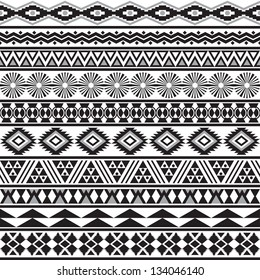 Tribal striped seamless pattern. Geometric black-white background. Swatches of seamless pattern included in the file.
