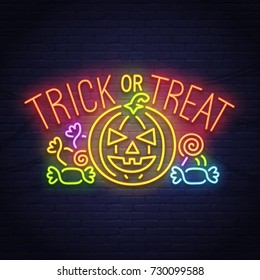 Trick or Treak. Pumpkin and candy neon sign. Happy Halloween. Neon sign, bright signboard, light banner.
