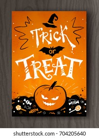 Trick or Treat Halloween postcard design with lettering, pumpkin and candies on wood background.
