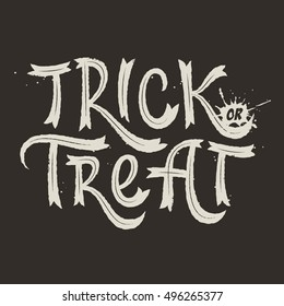 Trick or treat. Halloween vector hand lettering with grunge effects.