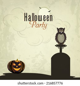Trick or Treat night party concept with little owl sitting on grave stone, scary pumpkins and spider web on grungy background.