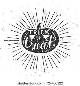 Trick or treat. Vector illustration with black silhouette of Halloween pumpkin, hand lettering, scroll and sunburst on white background with grunge texture. Typography poster, card, banner design.