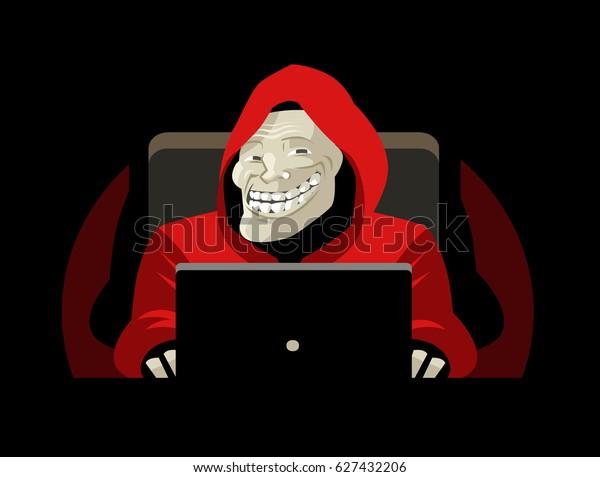 sonrisa troll con un ordenador
