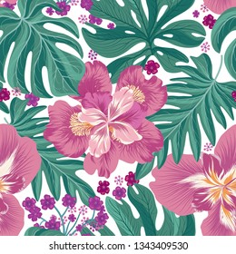 Tropcal flowers and palm leaves seamless pattern. Beautiful floral background. Summer nature wallpaper.