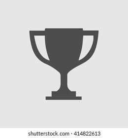 Trophy cup vector icon eps 10. Simple winner symbol. Black illustration isolated on grey background.