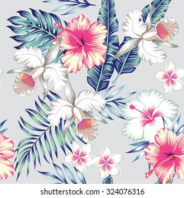 Tropic exotic hibiscus flowers, orchid, plumeria. In trendy blue background with green leaves of a banana palm tree. Floral seamless vector pattern. Hand drawn fashion print exclusive summer plant