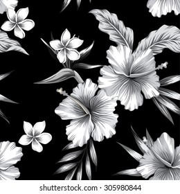 Tropic hibiscus flowers, plumeria and bird of paradise in composition with banana palm leaves. Print trendy seamless floral summer vector pattern in black and white style