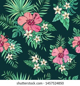 Tropic seamless pattern with hibiscus, plumeria and tropical leaves.Summer decoration print for wrapping, wallpaper, fabric. Seamless vector texture. Tropical bouquet flowers.