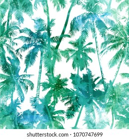 Tropical background seamless pattern of green silhouettes coconut palms on a white background