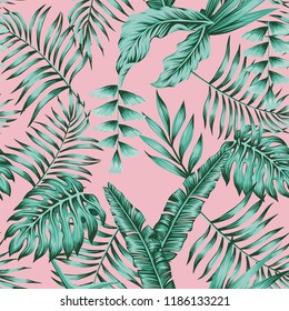 Tropical banana palm leaves green colors seamless pattern on the pink background