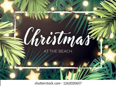 Tropical Christmas on the beach design with monstera palm leaves gold glowing stars and light bulb garlands, vector illustration.