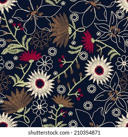 Tropical embroidery floral design in a seamless pattern .