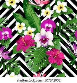 Tropical exotic flowers and leaves on black and white zig zag background. Seamless pattern. Vector.