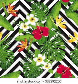 Tropical exotic flowers and leaves. Seamless pattern. Vector.