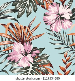 Tropical floral pink hibiscus flower orange palm leaves seamless pattern blue background. Exotic jungle wallpaper.