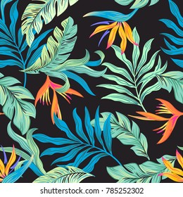 Tropical flower bird of paradise and blue leaves seamless vector pattern