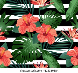 Tropical flowers and leaves on black and white striped background. Seamless. Vector.