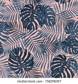 Tropical leaf design featuring navy blue Palm and Monstera plant leaves on a pink background. Seamless vector repeating pattern.