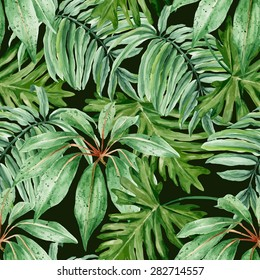 Tropical leaves, dense jungle. Seamless, hand painted, watercolor vector pattern on a dark background.