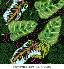 Tropical leaves floral print exotic seamless pattern. The texture of the fabric leaves of banana and palm trees. Exotic Hawaiian print for swimsuits.