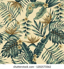 Tropical leaves and gold flowers seamless  cheerful pattern wallpaper of palm trees and bird of paradise (strelitzia) plumeria on a beige background