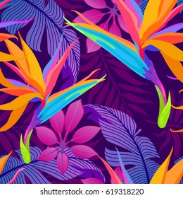 Tropical leaves and paradise flowers in night jungle. Seamless exotic detailed botanical pattern. Vector colorful trendy background.