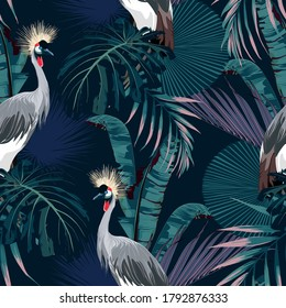 Tropical night vintage wild birds pattern, palm tree, palm leaves and plant floral seamless border black background. Exotic jungle wallpaper.  Japanese crane bird pattern.
