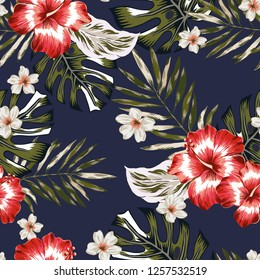 Tropical palm leaves, red hibiscus flowers, plumeria, black background. Vector seamless pattern. Jungle foliage illustration. Exotic plants. Summer beach floral design. Paradise nature