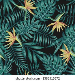 Tropical palm, monstera, fern leaves blue tone and bird of paradise flowers on the black background. Seamless vector pattern