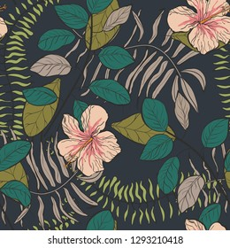 Tropical pattern with hibiscus flowers and leaves on a dark background. Floral background.